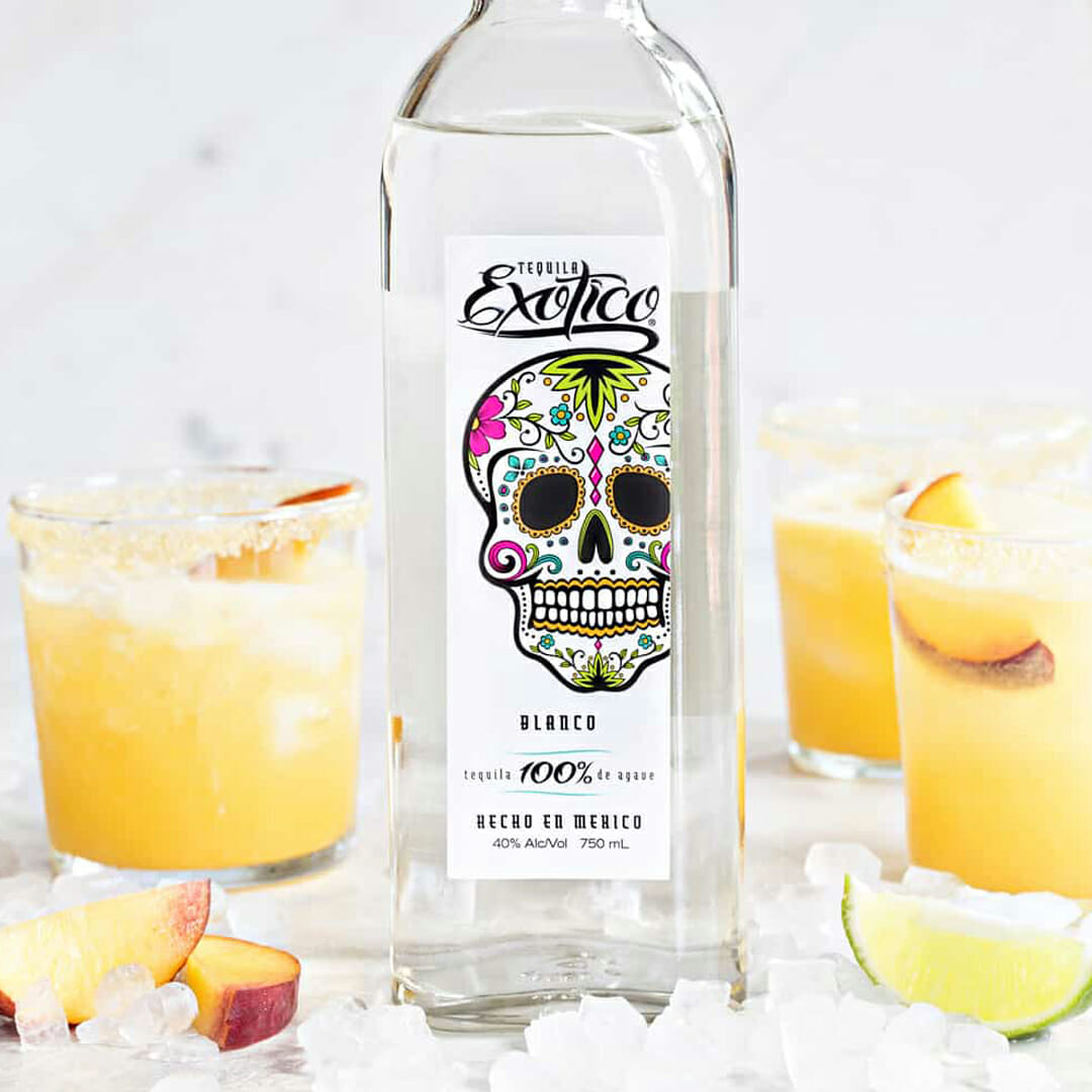 exotico tequila bottle with peach margaritas